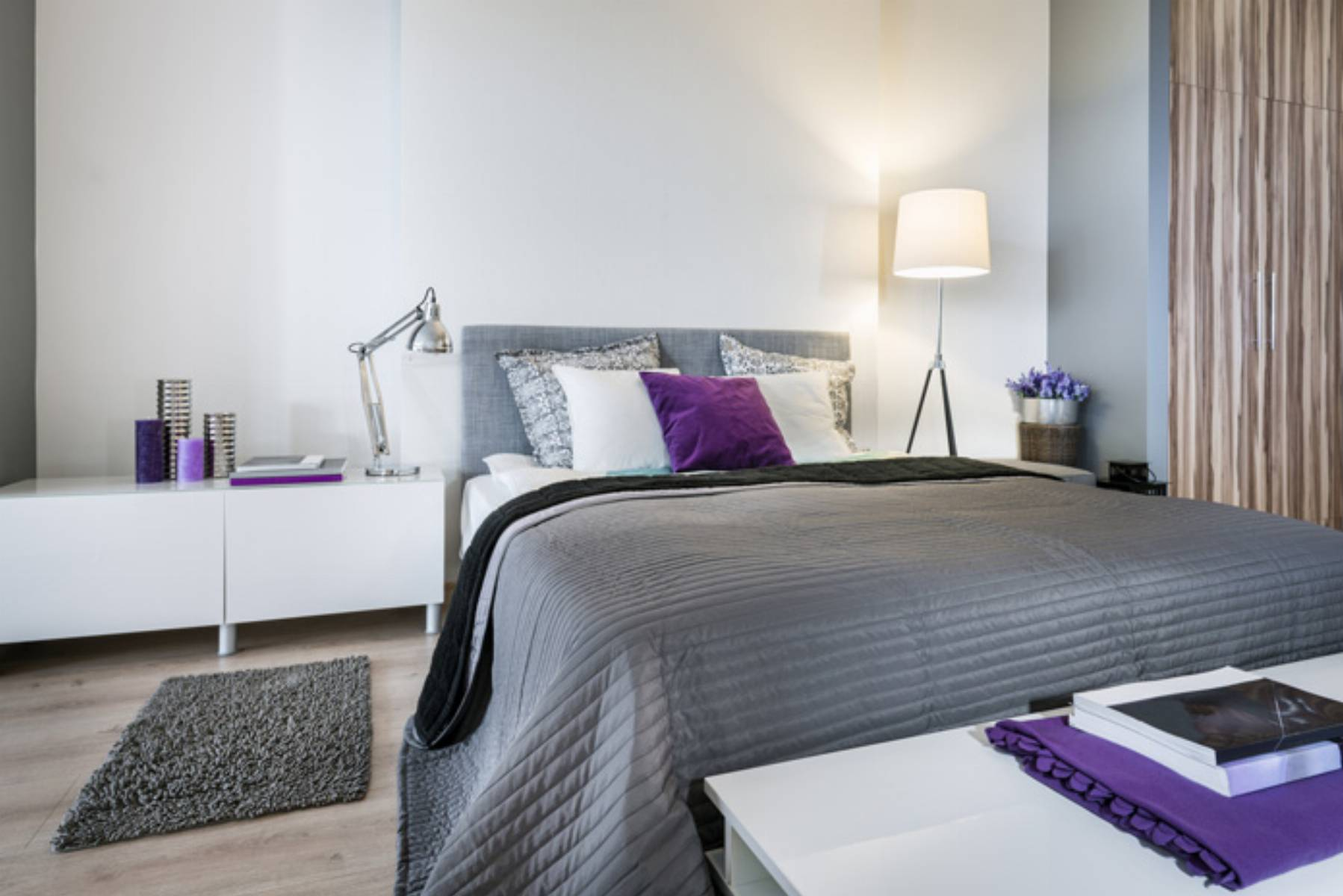 Bedroom interior with gray bed