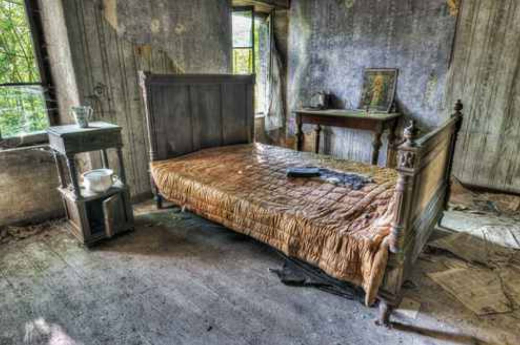 Decayed bedroom in an abandoned house