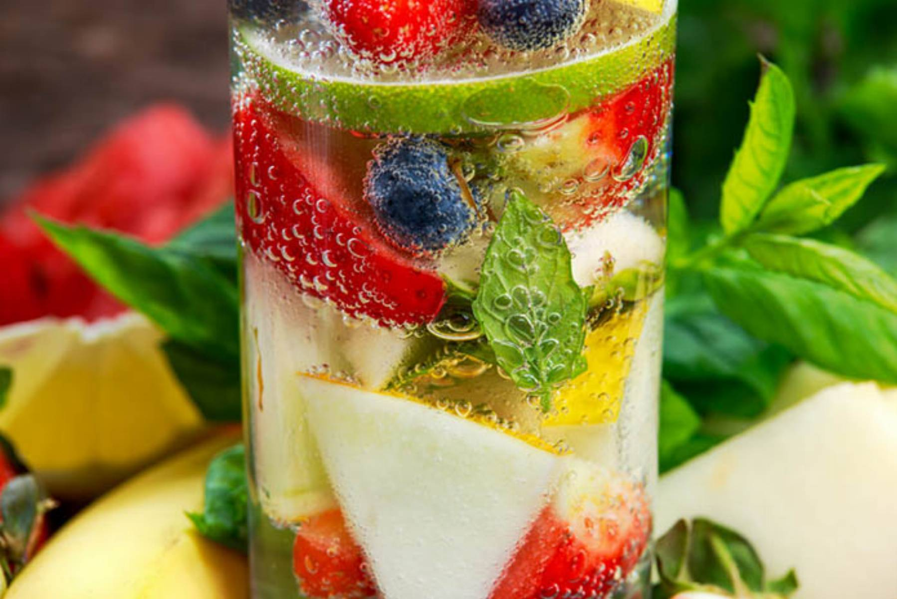 Glass of fresh strawberry detox water with fruit
