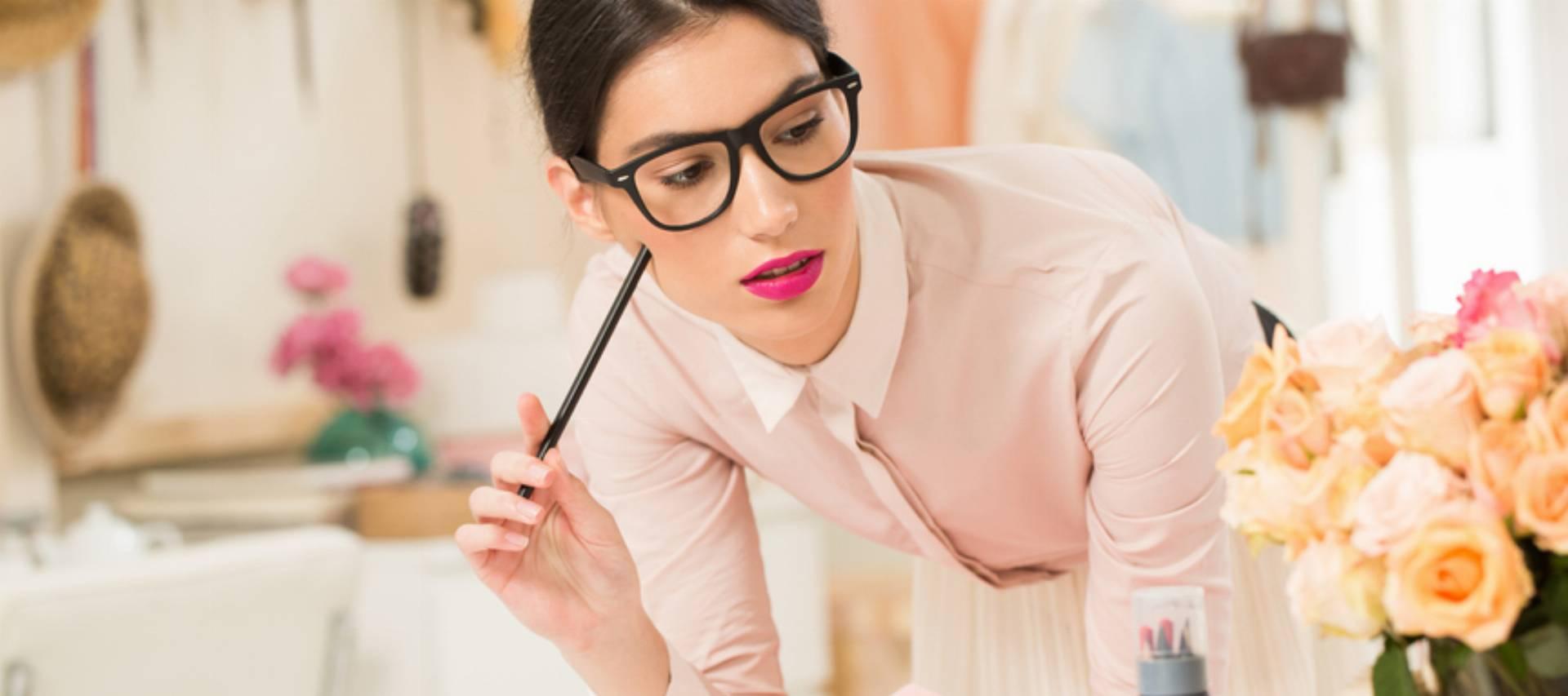 Fashion Designer Sketching at Her Studio